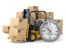 Forklift truck with  boxes and stopwatch .Express delivery conce Stock Photos