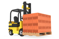 Forklift Truck with Bricks over pallet Royalty Free Stock Image