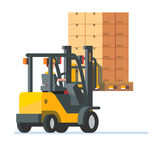 Forklift truck carrying a stacked boxes pallet Stock Photo