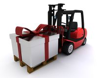 Forklift truck with christmas gift box Stock Photo