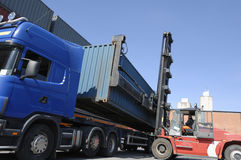 Forklift, truck and containers Stock Photo