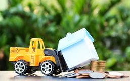 Forklift truck delivering coins to buy Royalty Free Stock Images