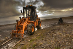 Forklift truck and excavator Royalty Free Stock Photos