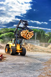 Forklift truck hauling logs at sawmill Royalty Free Stock Photo