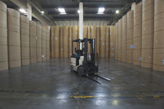 Forklift Truck And Huge Rolls Of Paper In Factory Royalty Free Stock Photo
