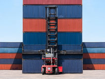 Forklift truck lifting cargo container in shipping yard Royalty Free Stock Photos