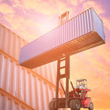 Forklift truck lifting cargo container in shipping yard Stock Photography