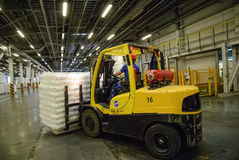 Forklift truck loads pallets with finished goods Stock Photos