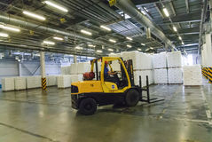 Forklift truck loads pallets with finished goods Royalty Free Stock Image