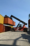 Forklift truck moves containers Stock Photography