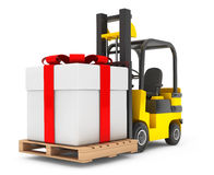 Forklift Truck moves Huge Gift Box Royalty Free Stock Photos