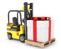Forklift Truck moves Huge Gift Box Royalty Free Stock Photo