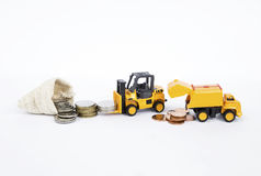 Forklift truck moving coins Royalty Free Stock Photos