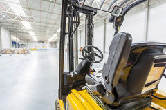 Forklift truck ready to use in modern storehouse. Forklift truck ready to use in a modern storehouse Stock Photo