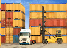 Forklift and truck with shipping containers. Forklift loading containers on white truck in horbor Stock Photography