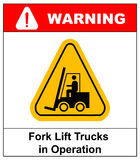 Forklift truck sign. Symbol of threat alert. Hazard warning icon. Black lift-truck with the silhouette of a man emblem Stock Photo