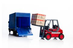 Forklift truck toys with boxes. Royalty Free Stock Images