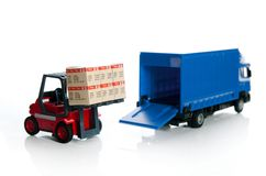 Forklift truck toys with boxes Stock Photography
