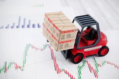 Forklift truck toys with boxes. Stock Photo