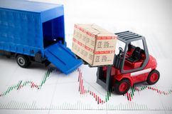 Forklift truck toys with boxes. Concept of international freight transport on business background Royalty Free Stock Images