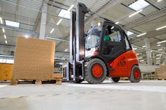 Forklift truck transport in a modern production facility Stock Photos