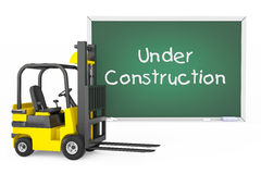 Forklift Truck with Under Construction Blackboard Royalty Free Stock Image