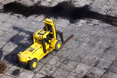 Forklift truck oil spilliage Stock Photos