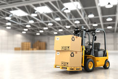 Forklift truck in warehouse or storage loading cardboard boxes. Royalty Free Stock Image