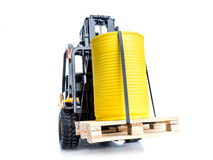 Forklift truck. With yellow container placed on wooden pallet shot on white background royalty free stock photo