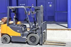 Forklift trucks for moving goods in warehouses. Warehouse in the open air Stock Photography
