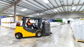 Forklift trucks transported in a warehouse - storage of goods in. A forwarding agency Royalty Free Stock Images