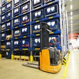 Forklift trucks in a warehouse in a factory with technical goods. For mechanical engineering royalty free stock image