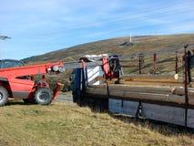 Forklift unload logs. View of Forklift unload logs royalty free stock images