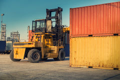 Forklift unloading and container stack in yard cargo shipping., Heavy equipment. Stock Photography