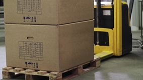 Forklift Unloading Stack Of Boxes stock footage
