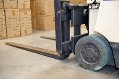 Forklift in warehouse stock image