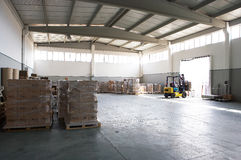 Forklift in warehouse. Big warehouse and forklift operator stock photos