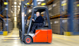 Forklift in warehouse royalty free stock photos