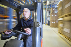 Forklift in Warehouse Royalty Free Stock Images