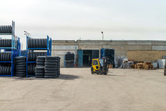 The forklift in the warehouse with the tires Royalty Free Stock Photos