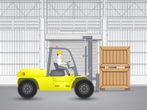 Forklift and wood crate Royalty Free Stock Photo