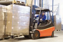 Forklift at work with driver Royalty Free Stock Photos