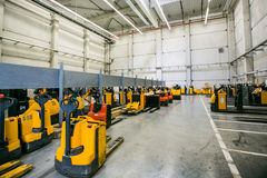 Forklift working at warehouse Stock Image