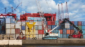 A forklift works in ship yard stock footage