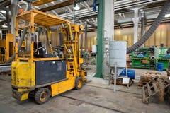 Forklift in workshop Royalty Free Stock Images