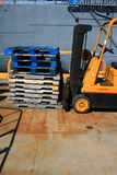 Forklifter. Yellow loaded forklifter truck in the industrial yard Royalty Free Stock Photos