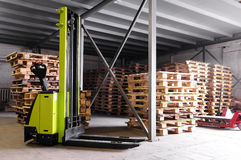 Forklifter stacker in warehouse Royalty Free Stock Photography