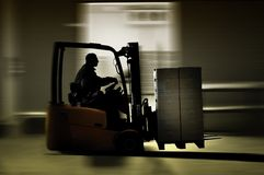Forklifter warehouse royalty free stock photography