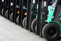 Forklifts. Line up of the forklifts in the warehouse Stock Images