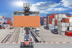 Forklifts container being unloaded container commercial delivery. Cargo at the harbor Royalty Free Stock Photos